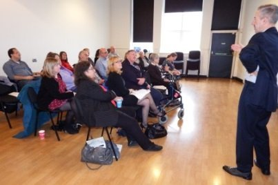 People gathered at the Cardiff and Vale Trustees' Network event, with David Poole of C3SC